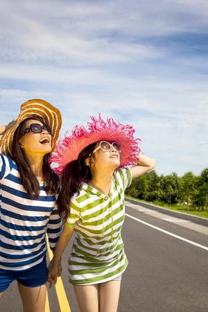 happy girls watching the sky and enjoy summer vocation Stock Photo - 12181518