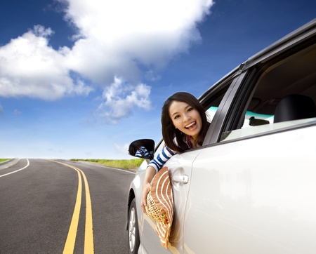 happy  young woman Sitting In the Car Stock Photo - 12181519