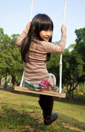 little girl on the swing photo