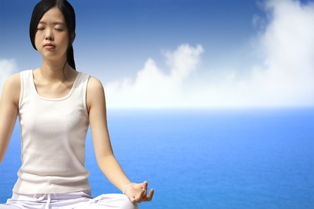 yoga woman with blue ocean background Stock Photo - 12362144