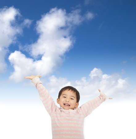 to raise: asian kid raising hands with sky background