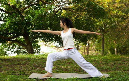 yoga woman on green grass photo