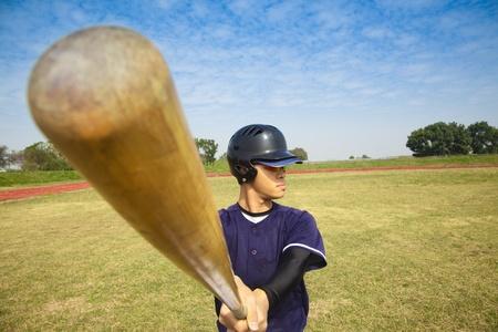 baseball swing: baseball player holding baseball bat