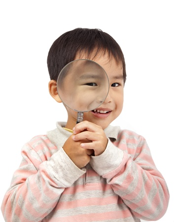 smiling boy holding magnifier photo