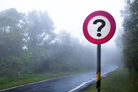 road mark: The road to the fog forest and question sign Stock Photo