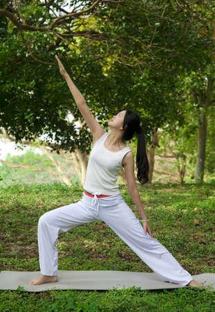 yoga woman on green grass photo