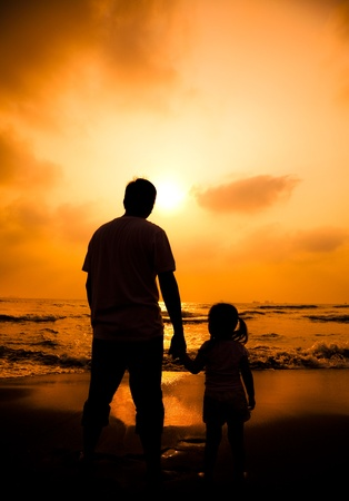 the silhouette of father holding little girl Stock Photo - 12613596