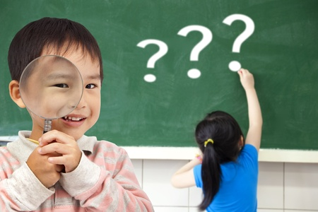 happy kids with drawing question mark in the classroom photo