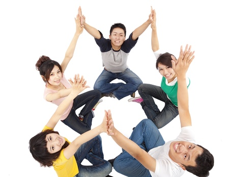 asian youth: happy young group connecting hands isolated on white