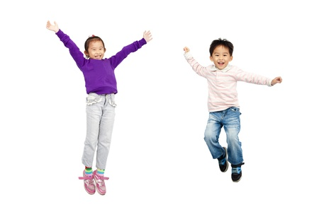 joy of life: happy boy and girl jumping together