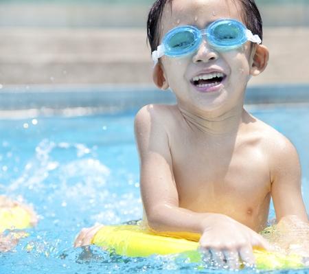 happy asian kid in Swimming Pool photo