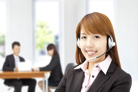 Smiling asian businesswoman  customer service on the phone photo
