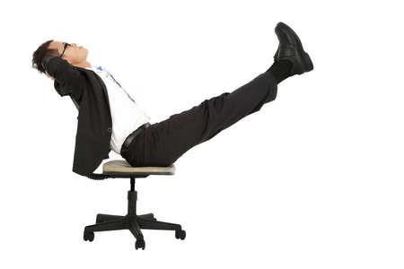 taking a break: businessman taking a break on the chair