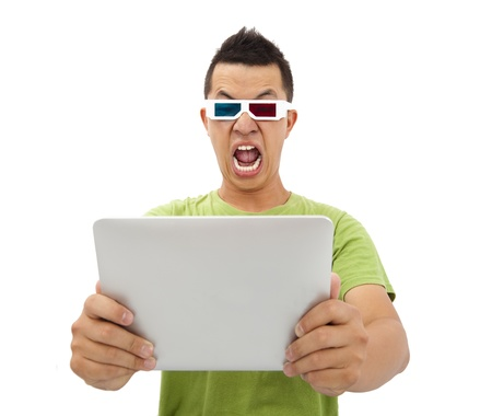 Surprised Young man in 3D glasses and watching the tablet pc photo