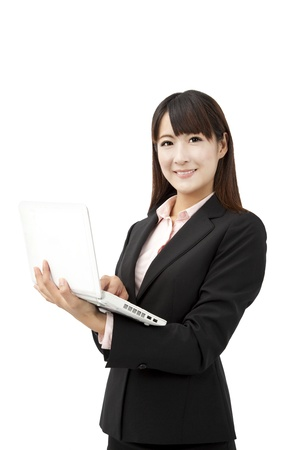 beautiful business woman holding laptop and isolated on white Stock Photo - 12870295