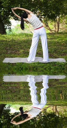 yoga girl with water reflecting Stock Photo - 12870297