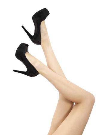 depilaciones: largas piernas de la mujer y sexy aisladas sobre fondo blanco