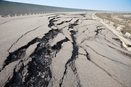 damages: cracked road after earthquake