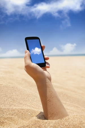 smart phone in hand and beach view with cloud computing concept photo