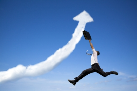 jumping businessman with business growing graph  cloud photo