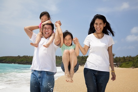 happy asian family: happy  family  on the beach