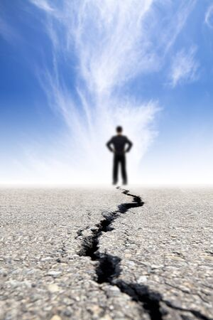 failed plan: businessman stand on the crack road