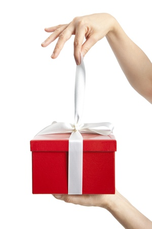 open present: hand holding ribbon and open gift box