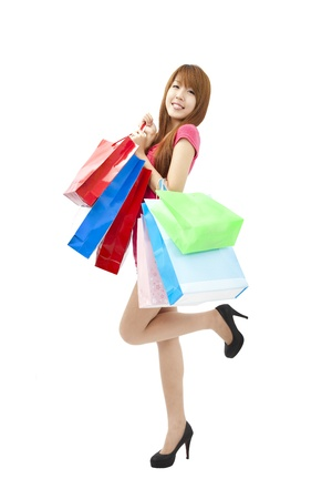 happy asian young woman with shopping bags photo