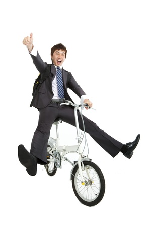 Happy asian  businessman on a bicycle isolated on white background photo