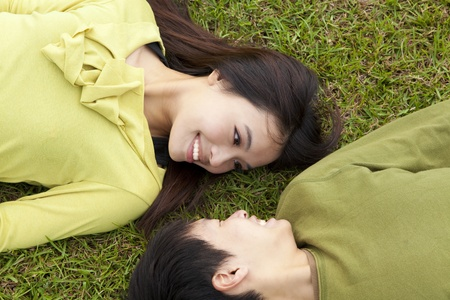 Young  couple in love on the meadow photo