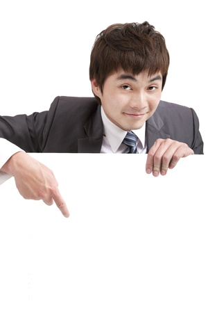 asian  businessman pointing empty board photo