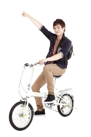 free riding: Happy asian young man on a bicycle isolated on white background