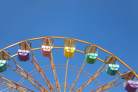 ferris wheel and blue sky background photo