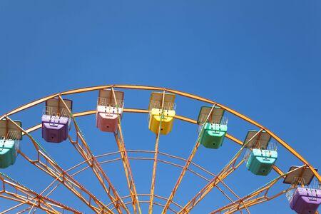 ferris wheel and blue sky background photo