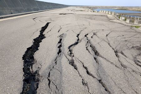 earthquake crack: collapse and cracked road