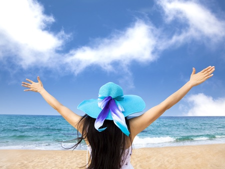 young woman raiseher hands up at the beach Stock Photo - 13295700