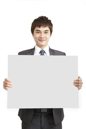 smiling asian business man holding empty board photo