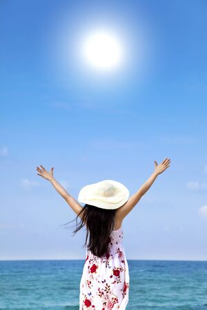 young woman on the beach enjoy sunlight Stock Photo - 13295737