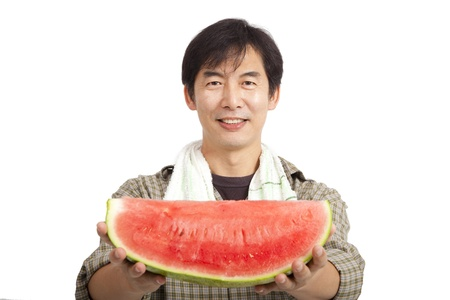 asian produce: middle age asian farmer holding Watermelon isolated on white Stock Photo