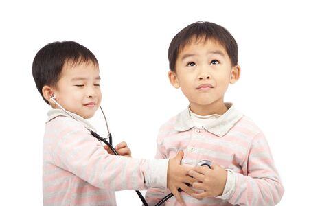 stethoscope boy: two boys using stethoscope Check the heartbeat Stock Photo