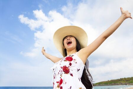 happy young woman raised hands on the beach Stock Photo - 13333582