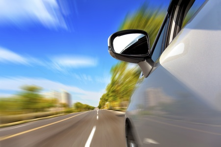 car on the road with motion blur background Stock Photo - 13464437