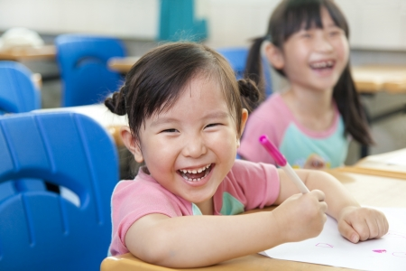 class room: happy little girls in the classroom