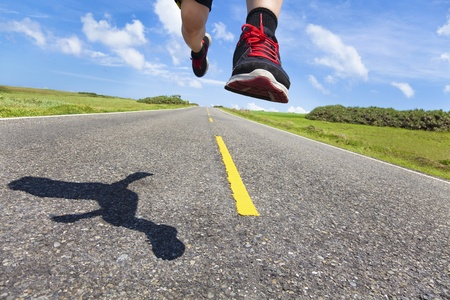 the legs and shoes of runner in action on the road Stock Photo - 13592692