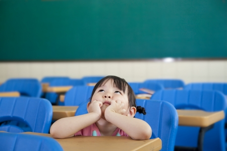 asian Little Girl are Thinking in the class room  Stock Photo - 13625436