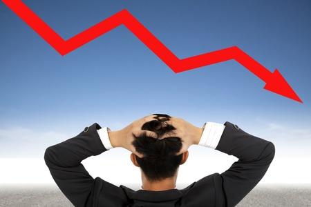 depression businessman watching  falling financial line Stock Photo - 13651347