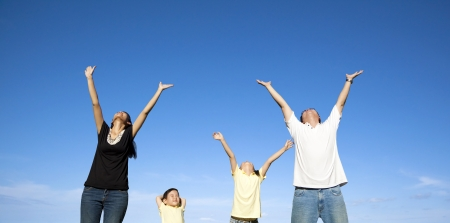 happy family watching the blue sky
