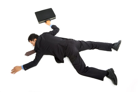 lay down: businessman lying down on the ground