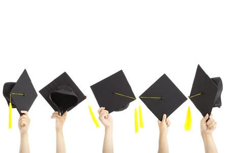 many hand holding graduation hats and isolated on white photo