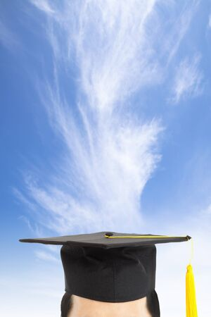 graduation cap and thinking concept with cloud background photo